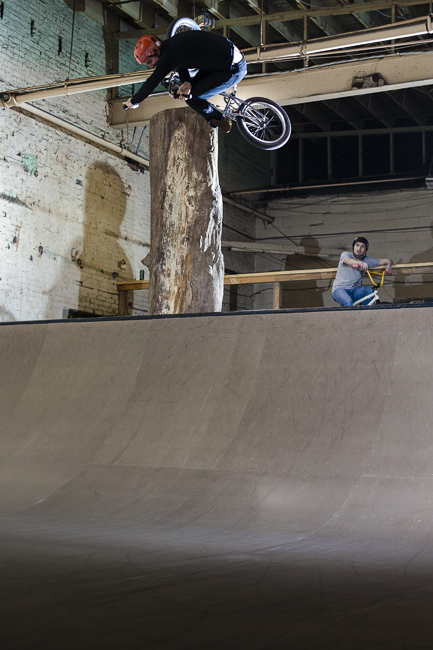 Mark Potoczny laying it upside down on the Wheel Mill's 6 foot mini ramp.