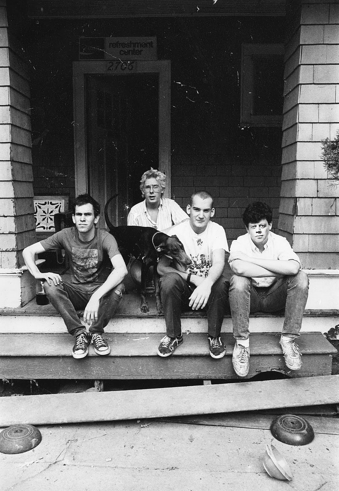 Minor Threat and Susie on Dischord House front porch, 1982 by Rebecca Hammel